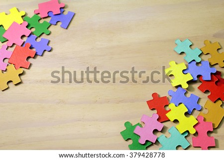 Puzzles on Wooden Background - stock photo