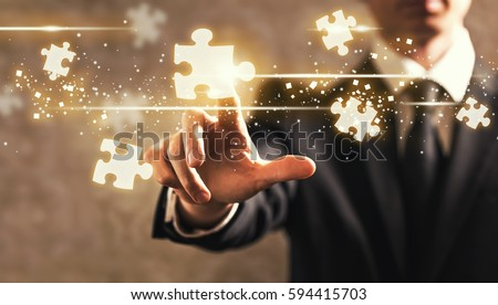 Puzzles with businessman on dark vintage background