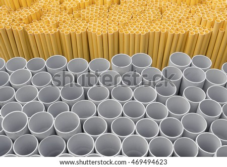 PVC pipes stacked in warehouse, Yellow pipe for electrical wiring and telephone cable conduit.