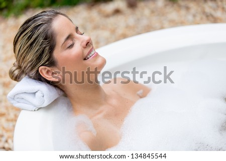 pwnsive woman having a foam bath - stock photo