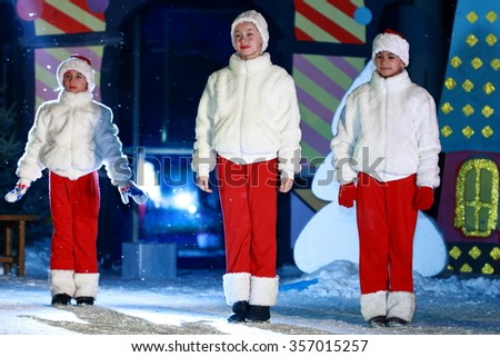 Pyatigorsk, Russia - December 31, 2015: Free for all show in a square near the City Administration building to celebrate New Year. Three girls dancing on a stage