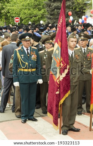 PYATIGORSK, RUSSIA - MAY 9 2014: Victory Day in WWII. Standard-bearers and column of people