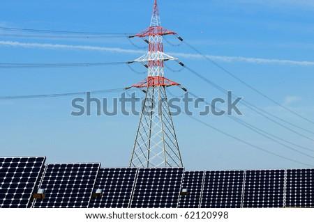 pylon and photovoltaic panels - stock photo