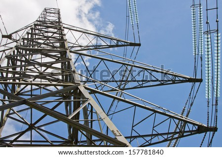 Pylon bearing high voltage cables across the English countryside - stock photo