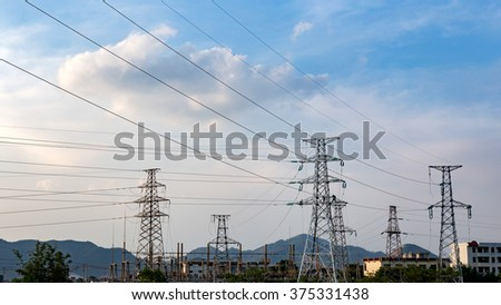 Pylon cable in the blue sky white cloud background - stock photo