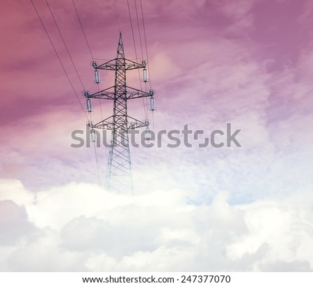 Pylon in the clouds - stock photo