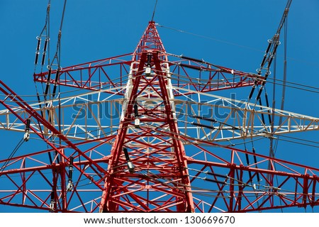 pylons of a high voltage power line. production and transport of energy. - stock photo