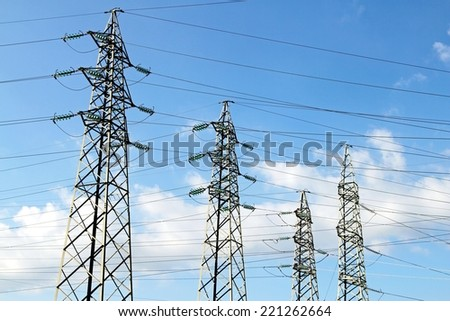 pylons of the high voltage electric cables in power station - stock photo