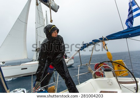 PYLOS, GREECE - CIRCA OCT, 2014: Sailors participate in sailing regatta 12th Ellada Autumn 2014 among Greek island group in the Aegean Sea, in Cyclades and Argo-Saronic Gulf.