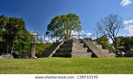 Pyramid and Stella in the ancient Mayan city of Copan in Honduras. - stock photo