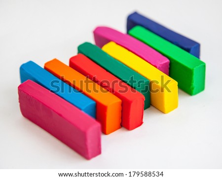 Pyramid from colorful plasticine on white background - stock photo