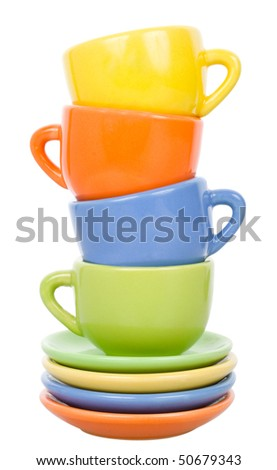 pyramid from multicolored cups and saucers - stock photo