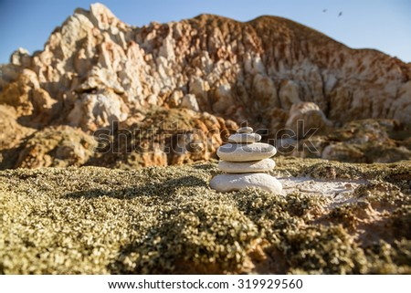 pyramid from smooth white stones in the desert - stock photo