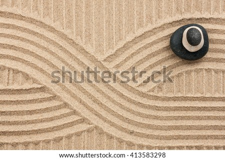 Pyramid  made of  stones standing on the strip sand, as background - stock photo