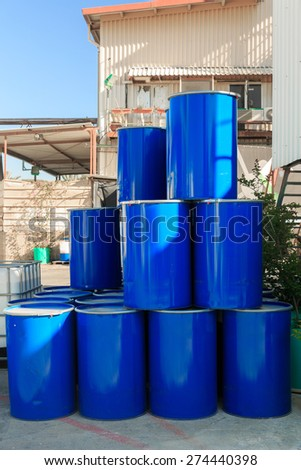 Pyramid of blue barrels on a chemical plant - stock photo