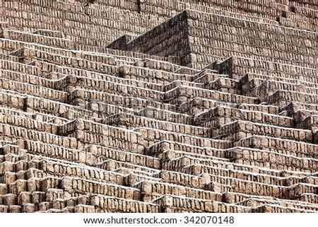 pyramid of bricks on a sunny day - stock photo