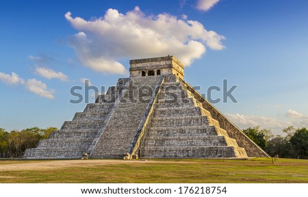 Pyramid of Chitchen Itza at sunset of the  21th march 2013 the only moment when you can see the shadow of kukulkan, feathered Serpent, projected on the side of the stairway - stock photo