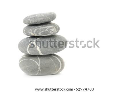 Pyramid of four striped stones over white. Soft focus - stock photo