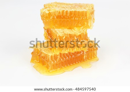 pyramid of honeycomb on white background