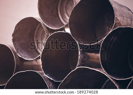 pyramid of old rusty opened cans - stock photo