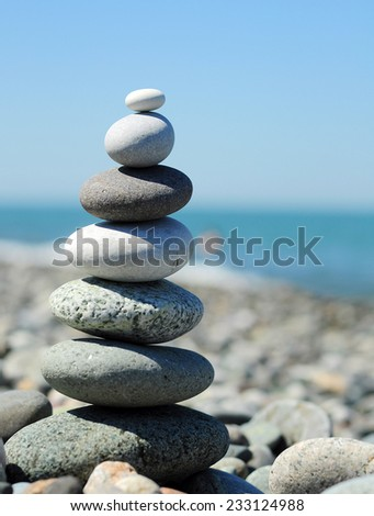 Pyramid of pebbles on the beach