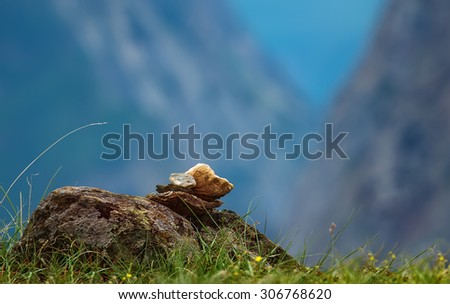 pyramid of stones on a blurred background - stock photo