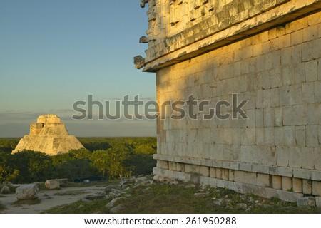 Pyramid of the Magician, Mayan ruin in the Yucatan Peninsula, Mexico at sunset - stock photo