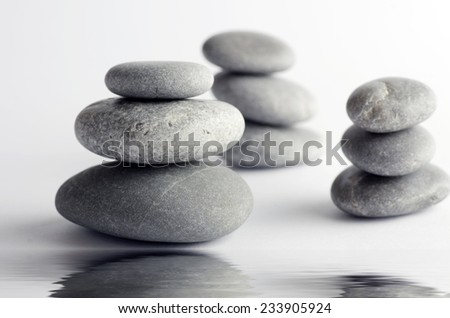 Pyramid of the stones isolated on white background  - stock photo