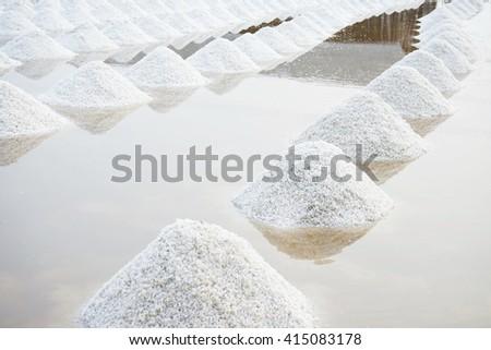 Pyramid Salt white. Crystallization of the salt brine awaiting transport to the factory. - stock photo