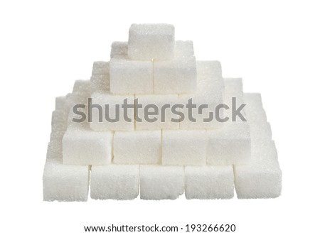 Pyramid stacked sugar cubes - unhealthy eating or diabetes concept - stock photo