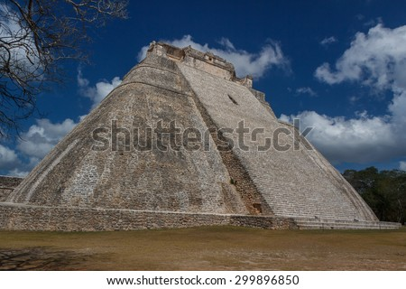 Pyramid the of the Magician in the ruins of the ancient Mayan city of Uxmal, Mexico - stock photo