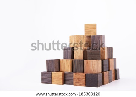 pyramidal construction of wooden cubes - stock photo