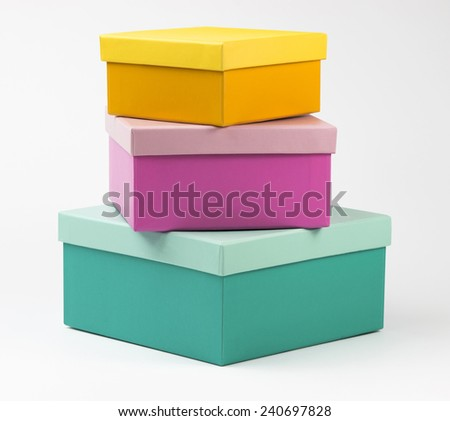 Pyramide of three multicolor boxes on white background with clipping path included - stock photo
