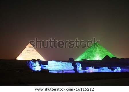pyramids of giza and sphynx at night - stock photo