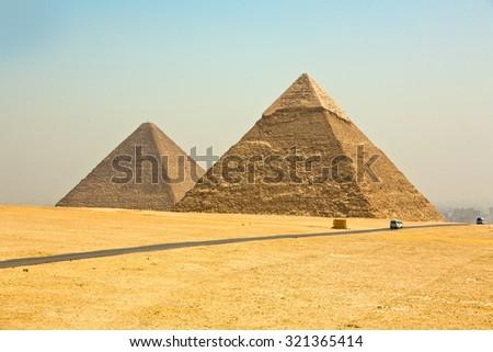 Pyramids of Giza on the outskirts of Cairo Egypt.  - stock photo