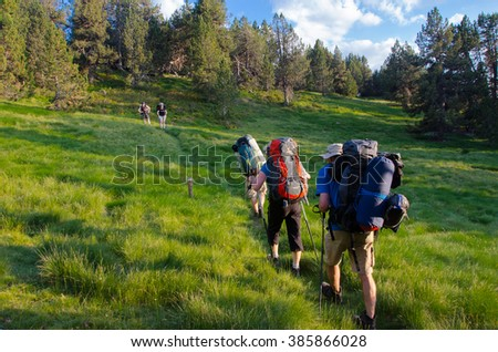 PYRENEES, SPAIN - CIRCA JULY, 2015 - Group of people walking in the Spanish Pyrenees (GR11 trail) near La Guingueta d'Aneu.