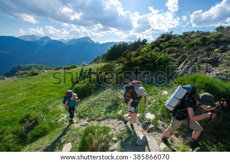 PYRENEES, SPAIN - CIRCA JULY, 2015 - Three  girls walking in the Spanish Pyrenees (GR11 trail) near La Guingueta d'Aneu girl walking in the Spanish Pyrenees (GR11 trail) near La Guingueta d'Aneu