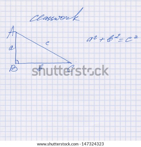 Pythagoras rule explained in the exercise book, Pythagorean theorem sketched on the white squared paper sheet texture or background, isolated, Hand drawn pictures
