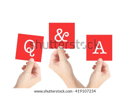 Q and A written on cards held by hands - stock photo