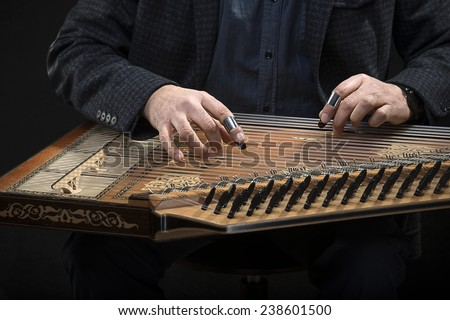 Qanun, a zither like instrument with seventy-eight strings. - stock photo