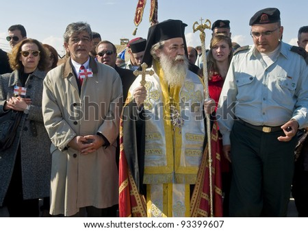 QASER EL YAHUD , ISRAEL - JAN 18 : The greek orthodox patriarch participates in the baptising ritual during the epiphany at Qaser el yahud , Israel in January 18 2012