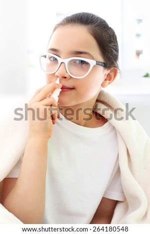 Qatar and cold, dripping nose sick child. Sick girl dripping nose drops  - stock photo
