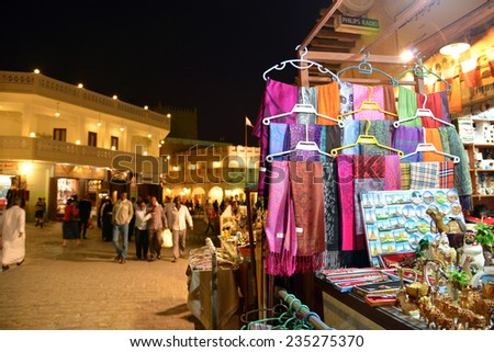 QATAR, DOHA - March 20 2014: Souq Waqif is a main marketplace selling traditional garments, spices, handicrafts, and souvenirs. It is a good place for dinner in Doha. - stock photo