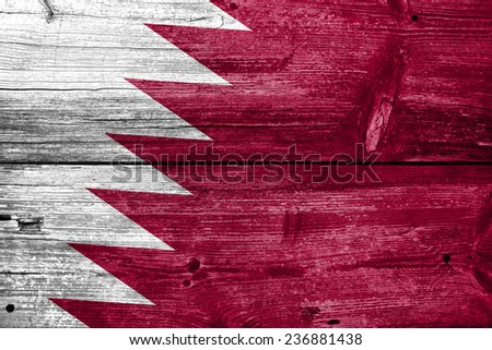 Qatar Flag painted on old wood plank texture - stock photo
