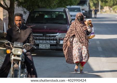 Qeshm, Iran - December 20, 2015: Bandari woman wearing a traditional mask called the burqa, Qeshm Island, Iran - stock photo