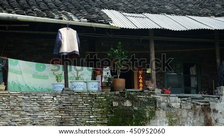 QIANYANG, HUNAN PROVINCE, CHINA - MAY 2016: A rural house in Qianyang Ancient Town which has history of over 2,000 years. It still remains some propaganda from Cultural Revolution in the past. - stock photo
