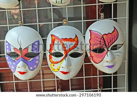 QIBAO, SHANGHAI-MARCH 16, 2010: Chinese opera masks. The Qibao water village visited by thousands of people has many shops selling opera mask. - stock photo