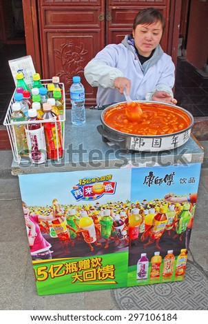 QIBAO, SHANGHAI-MARCH 16, 2010: vendor proposing pasta with tomatoes and drinks.  Qibao water village is Shanghai tourist attraction with 1000000 visitors year. - stock photo