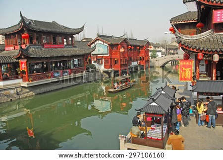 QIBAO, SHANGHAI-MARCH 16, 2010: village canal at sunset. Qibao water village is Shanghai tourist attraction with 1000000 visitors year. - stock photo
