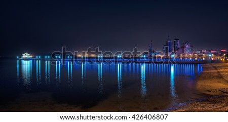 QINGDAO, CHINA - 24 MARCH, 2016: View on Qingdao at night in Qingdao, China on 24 March, 2016.